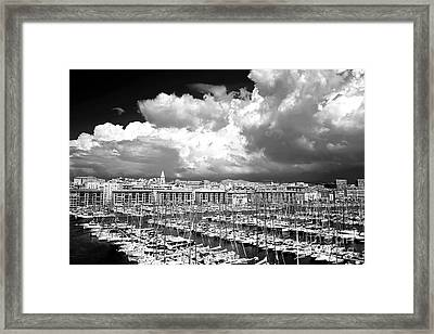 Clouds Rolling In Over The Port Framed Print by John Rizzuto