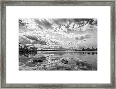 Clouds Touching The Water Framed Print by Jon Glaser