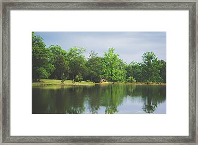 Cloudy Day By The Lake Framed Print by Shelby Young