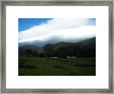 Cloudy Hills Framed Print