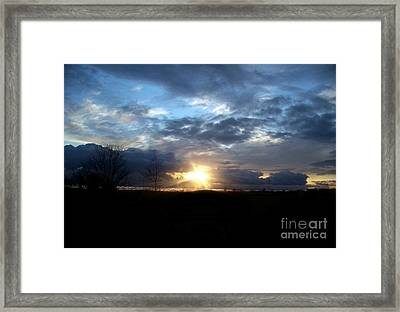 Cloudy Sunset Framed Print by Emily Kelley