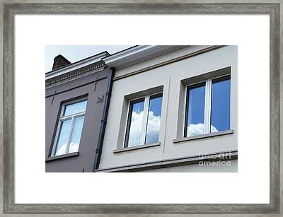 Cloudy Windows Framed Print