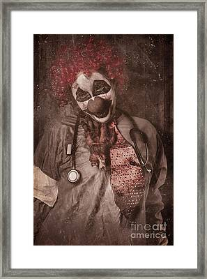 Clown Doctor Being Strangled By Autopsy Limb Framed Print by Jorgo Photography - Wall Art Gallery