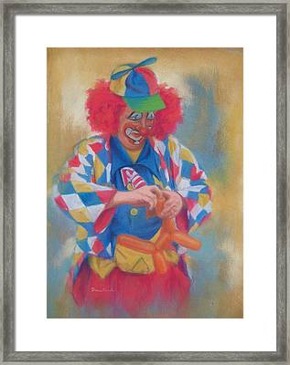 Clown Making Balloon Animals Framed Print by Diane Caudle