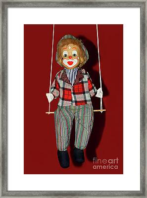 Framed Print featuring the photograph Clown On Swing By Kaye Menner by Kaye Menner