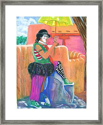 clown on Taos plaza Framed Print by George Chacon