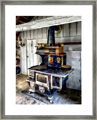 Coal Stove In Kitchen Framed Print by Susan Savad