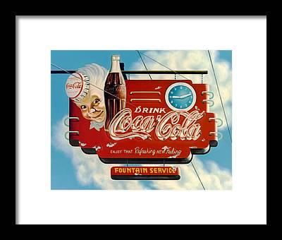 Cola Framed Prints