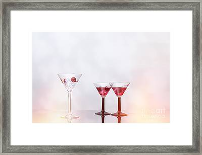 Cocktail Glass Filled With Ice  Framed Print by Amanda Elwell
