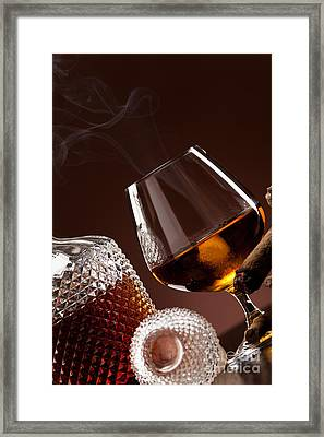 Cognac In Snifter And A Cigar Framed Print by Wolfgang Steiner