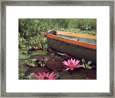 Colombian Boat And Flowers Framed Print by Lawrence Costales