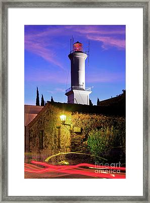 Framed Print featuring the photograph Colonia Lighthouse by Bernardo Galmarini