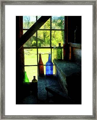 Framed Print featuring the photograph Colored Bottles On Steps by Susan Savad