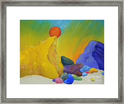 Colored Rocks In Sand Framed Print by Emily Michaud