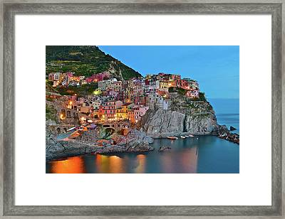 Framed Print featuring the photograph Colorful Buildings Colorful Lights by Frozen in Time Fine Art Photography