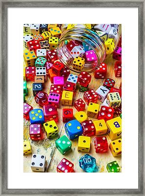 Colorful Dice Spilling From Jar Framed Print