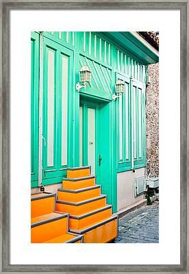 Colorful House Framed Print by Tom Gowanlock
