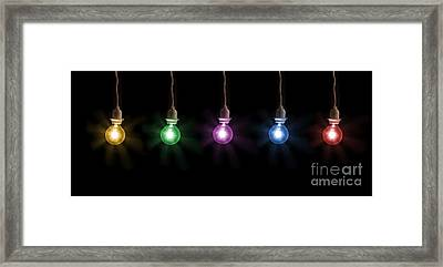 Colorful Light Bulbs Framed Print by Sharon Dominick