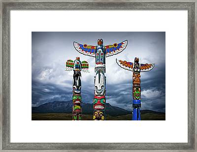 Colorful Totem Poles In The Northwest Framed Print by Randall Nyhof