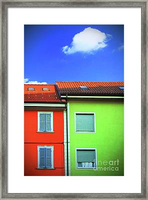 Colorful Walls And A Cloud Framed Print by Silvia Ganora