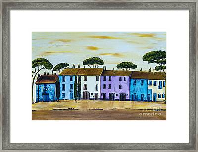Coloured Houses In A Row In Tuscany Framed Print by Christine Huwer