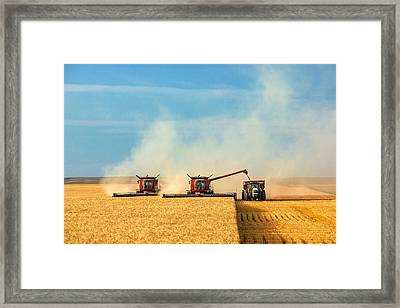 Combines And Tractor Working Together Framed Print by Todd Klassy