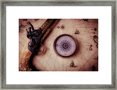 Compass And Pistole On Old Map Framed Print