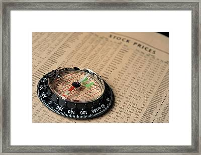 Compass On Stockmarket Cotation In Newspaper Framed Print by Sami Sarkis