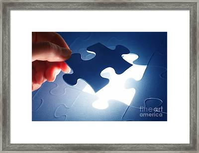 Completing The Last Piece Of Jigsaw Puzzle Framed Print
