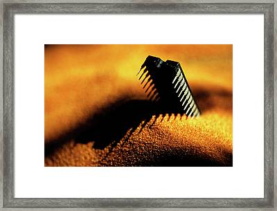 Computer Chip Half-buried In Sand Framed Print by Sami Sarkis