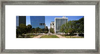 Confederate Monument With Buildings Framed Print