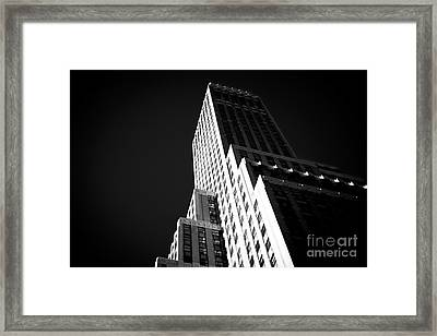 Framed Print featuring the photograph Conflict In The City by John Rizzuto
