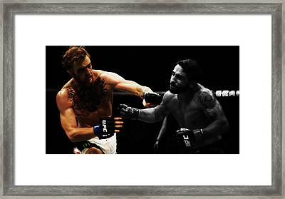 Conor Mcgregor And Chad Mendes Framed Print by Brian Reaves