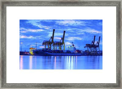 Container Cargo Freight Ship With Working Crane Bridge In Shipya Framed Print by Anek Suwannaphoom