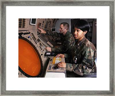 Control Technicians Use Radarscopes Framed Print by Stocktrek Images