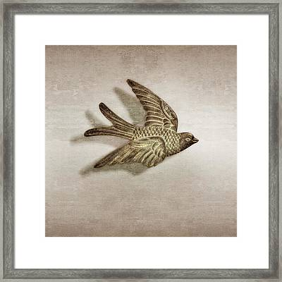 Copper Bird Framed Print