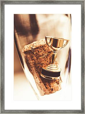 Cork And Trophy Floating In Champagne Flute Framed Print