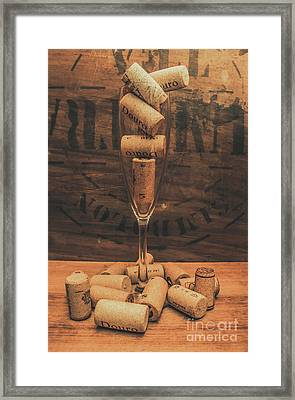 Corks Balanced On An Empty Champagne Flute Framed Print by Jorgo Photography - Wall Art Gallery