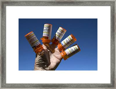 Cost Of Medication Framed Print by Carl Purcell