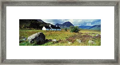 Cottage On A Landscape, Black Rock Framed Print by Panoramic Images