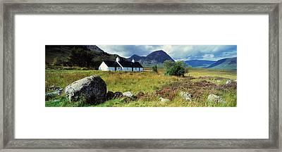 Cottage On A Landscape, Black Rock Framed Print