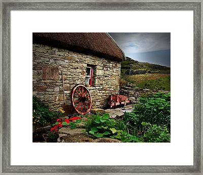 Cottage On The Moor Framed Print