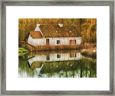Cottage Reflection Framed Print by Wim Lanclus
