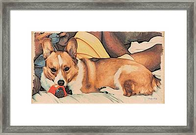 Framed Print featuring the digital art Couch Corgi Chewing A Ball by Kathy Kelly