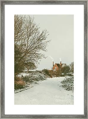 Country Cottage In Snow Framed Print