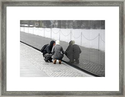 Couple At Vietnam Wall Framed Print