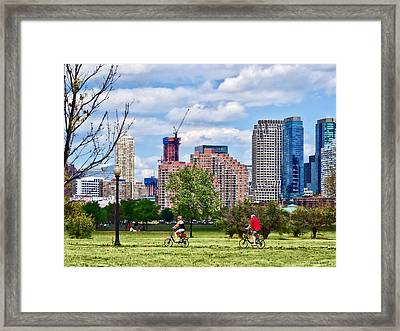 Couple Cycling In Liberty State Park Framed Print
