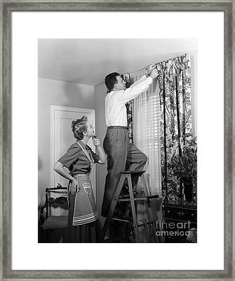 Couple Hanging New Drapes, C.1950s Framed Print