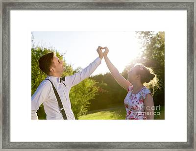 Couple In Love Making A Heart Shape With Their Hands In Sunshine Framed Print