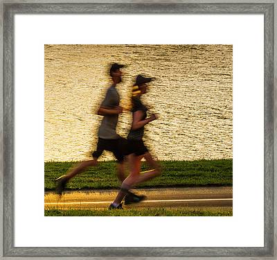 Couple Jogging In Forest Park Framed Print by Garry McMichael